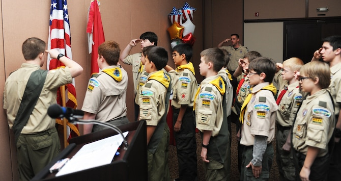 The Boy Scouts of America Troop 44 recites the Scouts' Law at a dinner held in their honor at the Recce Point Club on Beale Air Force Base Calif., Jan. 26.  Troop 44 was celebrating its 50th anniversary. (U.S. Air Force photo by Airman 1st Class Bobby Cummings/Released)