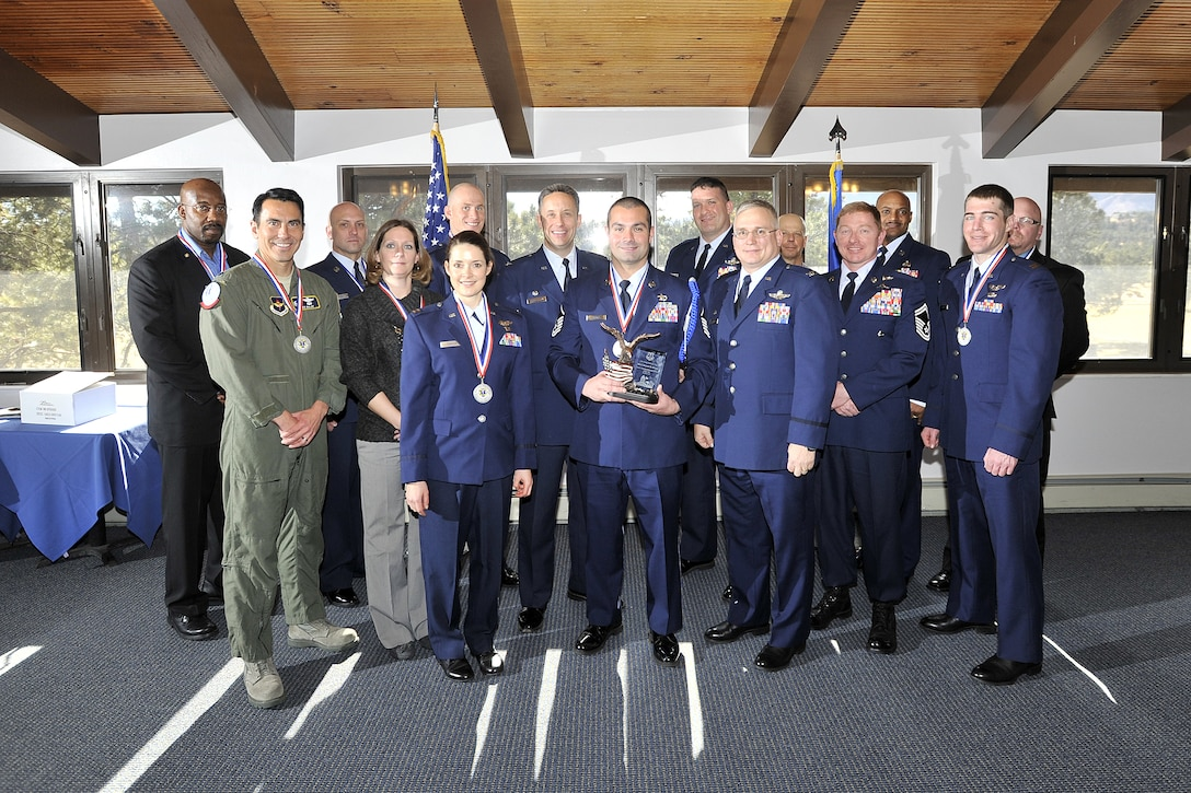 Annual award nominees from the 12th Flying Training WIng's 306th Flying Training Group pose for a photo with 12th FTW leadership after the ceremony at the U.S. Air Force Academy, Colo., January 28, 2013.  Due to its geographically separated nature, members of the wing's 306th and 479th Flying Training Groups were not able to attend the wing's formal banquet held at Joint Base San Antonio-Randolph, Texas January 25.  Instead they were honored at individual events at their respective home stations, the U.S. Air Force Academy, Colo., and Naval Air Station Pensacola, Fla. on January 28 and 29.  Typically all nominees are sent TDY to the ceremony, but having separate events saved the wing nearly $30,000.
