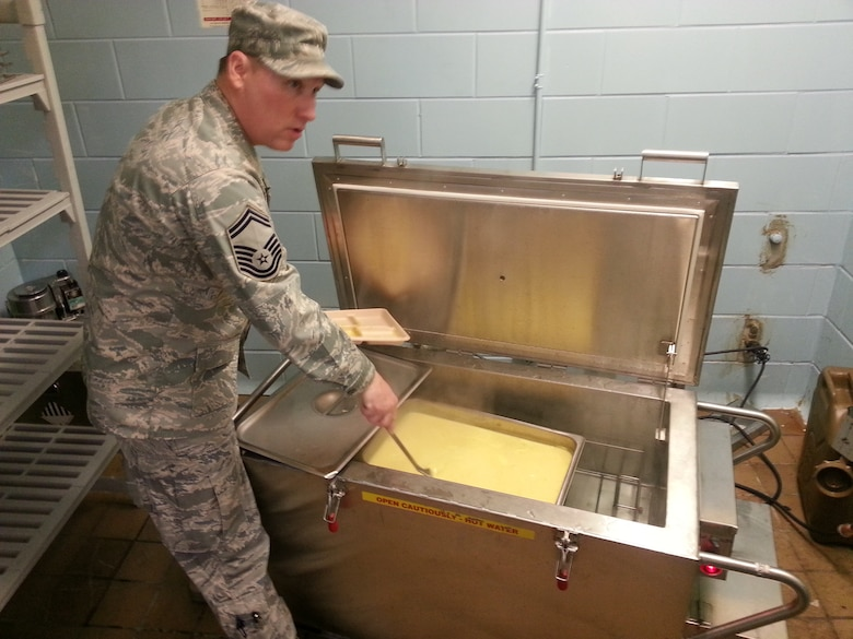 Senior Master Sgt. Scott Balko of the 152nd Sustainment Services Flight prepares eggs for Tennessee National Guard members while supporting the 2013 Presidential inauguration.  Balko was one of nine High Rollers who traveled to the District of Columbia for the ceremony.  USAF Photo by David Hill (released).