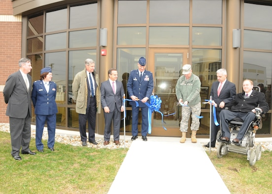 Colonel Arthur Floru, Commander (center left), 143d Airlift Wing, Rhode Island Air National Guard, North Kingstown, Rhode Island, and Major General Kevin McBride (center right), Adjutant General, Commanding General, Rhode Island National Guard cut the ceremonial ribbon in front of the brand new Air Traffic Control Tower at Quonset Air National Guard Base, North Kingstown, RI. Also pictured from Left to Right are Mr. Phillip Cox, Civil Engineer, Lieutenant Colonel Kimberly Keller, 143d Mission Support Group Deputy Commander, Senator Sheldon Whitehouse, Congressman David Cicilline, Senator Jack Reed, and Congressman Jim Langevin. National Guard Photo by Technical Sergeant Jason Long (RELEASED)