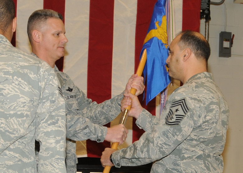 Incomming Command Chief Master Sergeant Jose Baltazar, 143d Airlift Wing (AW), Rhode Island Air National Guard, assumes authority as the Command Chief of the 143d AW from Colonel Arthur Floru, Commander of the 143d AW at a ceremony held at Quonset Air National Guard Base, North Kingstown, Rhode Island. National Guard Photo by Master Sergeant John McDonald (RELEASED)