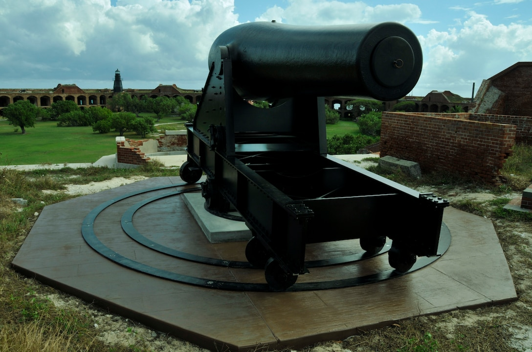 A fully restored cannon on a reproduction carriage and concrete base at Fort Jefferson in the Dry Tortugas National Park Jan. 17. Air Force reservists both active and retired from Homestead Air Reserve Base's 482nd Civil Engineer Squadron gathered at Fort Jefferson over several days in January to participate in a maintenance project for the National Park Service. 15 active reservists, six retired reservists, and one civilian contractor set up shop at Fort Jefferson as a training mission. The main project of the training was the construction of four reinforced concrete bases for large, 24-ton restored cannons to replicate the historical weapon's footprint. (U.S. Air Force photo/Ross Tweten)