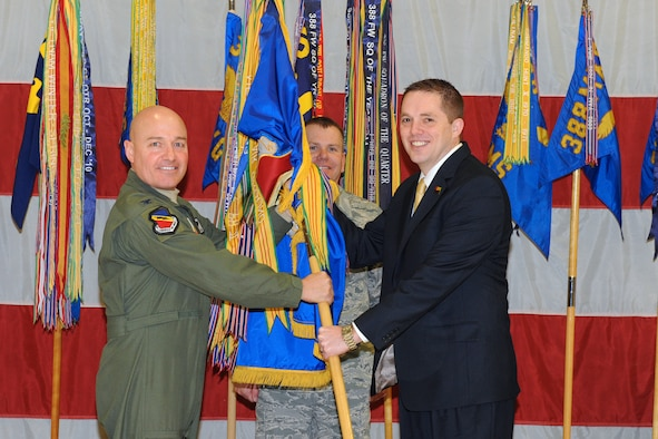 Community members and business leaders were appointed as 388th Fighter Wing Honorary Commanders during a special change of command ceremony at Hill Air Force Base, Utah, Jan. 25. Col. Scott Long (left), 388th FW commander, hands the wing's guidon to his new honorary, Kaysville City Mayor Steve Hiatt, while Chief Master Sgt. Mark Batzer, 388th command chief, looks on. (U.S. Air Force photo/Released by Alex Lloyd)