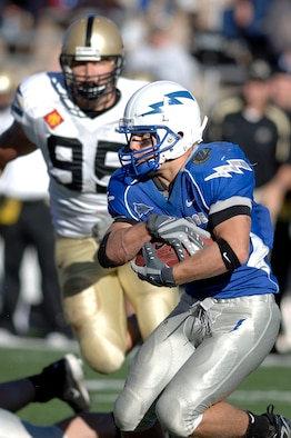 Air Force wide receiver Chad Hall tries to juke past an Army defender during the Falcons-Black Knights game at Falcon Stadium Nov. 3, 2007. Hall accounted for 275 yards rushing, 19 yards receiving and one rushing touchdown in the Falcons' 30-10 victory. Hall signed with the San Francisco 49ers in November 2012 and is scheduled to appear with them at Super Bowl XLVII. (U.S. Air Force photo/Mike Kaplan)