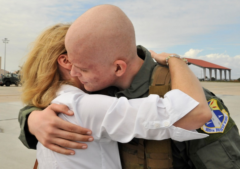 Air Force Junior ROTC cadet Coleton Wells hugs his mother Cara Wells prior to his flight on a HH-60G Pave Hawk rescue helicopter.  Wells spent the day touring the 920th RQW and learning the ins and outs of rescue. (U.S. Air Force photo/Tech. Sgt. Peter Dean)
