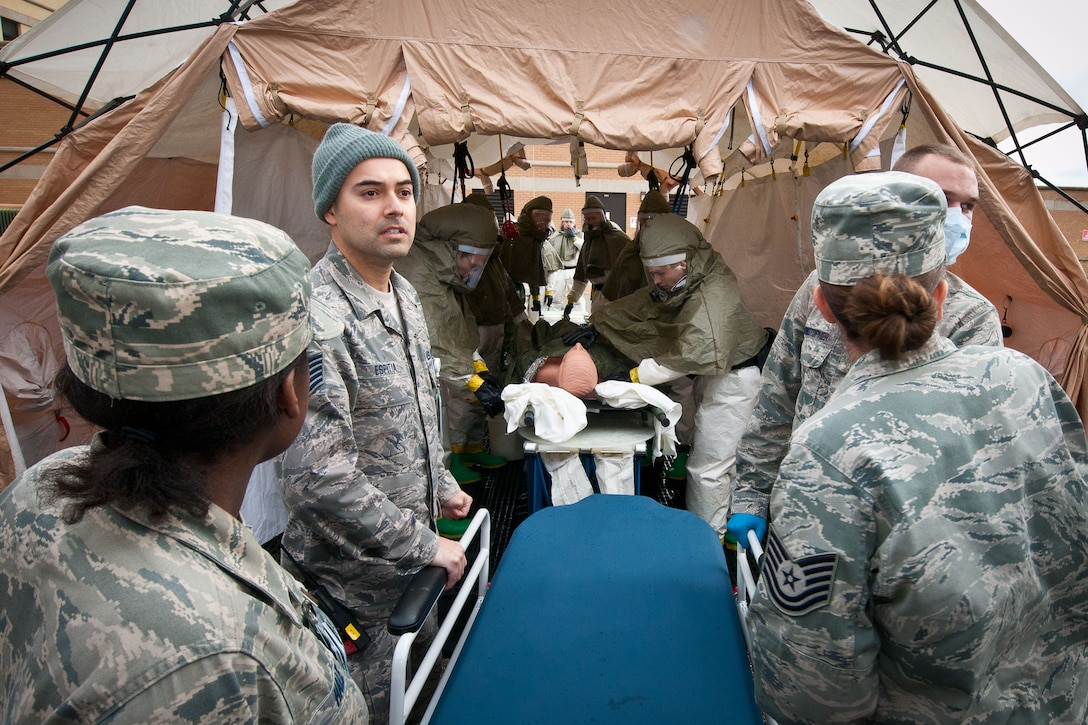 The triage team determines which patients are seen by the in-place decontamination team, which cleans the patients. The team must confirm the patients are decontaminated before the manpower and clinical team takes them to the clinic for evaluation. (U.S. Air Force photograph by Donna L. Burnett)