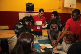 During Viva Technology Day at Roosevelt High School in Los Angeles, Jan. 18, 2013, students participated in hands-on competitive, educational challenges. They worked in teams led by college students (red shirts) and District interns who major in science, technology, engineering and mathematics, or STEM.