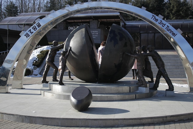 A monument dedicated to reunification and peace sits outside the entrance to the 3rd Infiltration Tunnel, which is part of the Korean Demilitarized Zone tour, which stops by all the main tourist attractions up to the Military Demarcation Line.