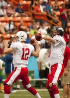 Denver Broncos quarterback Peyton Manning warms up with rookie Pro Bowler and Indianapolis Colts quarterback Andrew Luck at Aloha Stadium before the 2013 NFL Pro Bowl, Jan. 27. Luck replaced Manning as Colts quarterback last year, but both took their team to the playoffs and were selected to the Pro Bowl for their superior performance.