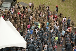 Hawaii-based Marines, Sailors and their families check in before they make their halftime appearance during the NFL Pro Bowl at Aloha Stadium, Jan. 27. The Marines who participated in the halftime show recently returned from deployment.