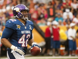 Minnesota Vikings fullback Jerome Felton brings the game ball back to the sidelines after scoring a touchdown during the 2013 NFL Pro Bowl at Aloha Stadium, Jan. 27. The Marines at the Pro Bowl contributed to the festivities with a color guard, stage assistance, a troop formation and a welcoming home for Marines recently returned from deployment at halftime.