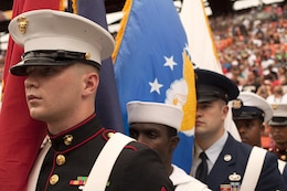 Cpl. Joseph Stewart (left), the property clerk with Headquarters and Service Battalion, U.S. Marine Corps Forces, Pacific, and his fellow servicemembers prepare to march the colors onto the field for the national anthem during the 2013 NFL Pro Bowl at Aloha Stadium, Jan. 27. The Marines at the Pro Bowl contributed to the festivities with a color guard, stage assistance, a troop formation and a welcoming home for Marines recently returned from deployment at halftime.