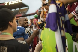 Minnesota Vikings running back Adrian Peterson signs autographs for waiting fans after the 2013 NFL Pro Bowl at Aloha Stadium, Jan. 27. Peterson nearly broke the single-season NFL rushing record this year, falling only nine yards shy. Peterson stayed long after the game to sign autographs.