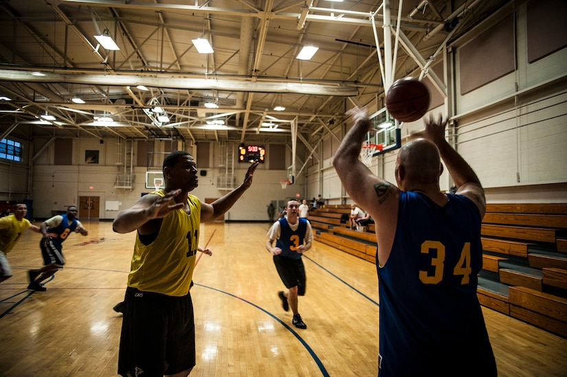 Adrian Johnson, 628th Comptroller Squadron, passes the ball during a game against the 628th Logistics Readiness Squadron Jan. 29, 2013, at Joint Base Charleston, S.C. The 628th LRS beat the 628th CPTS 52 to 46. Games are scheduled to be played on Tuesday, Wednesdays and Thursdays at 5:30, 6:30 and 7:30 p.m. at the Fitness Center at the JB Charleston - Air Base. (U.S. Air Force photo/ Senior Airman Dennis Sloan)