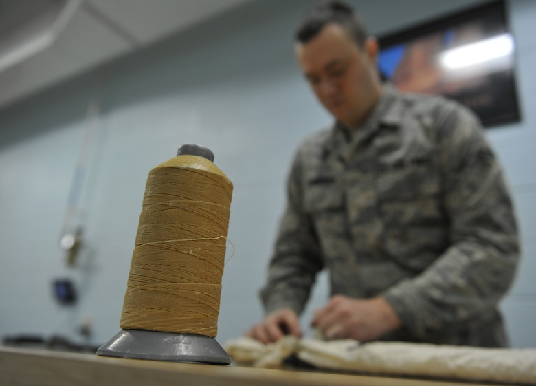 WHITEMAN AIR FORCE BASE, Mo. -- Airman 1st Class Chris Lineberry, 509th Operations Support Squadron aircrew flight equipment journeyman, checks the pull-test on the restrictor lanyard, Jan. 18. Airmen conduct pull-tests to ensure correct opening sequence on a parachute in case it were to deploy. (U.S. Air Force photo/Heidi Hunt) (Released)
