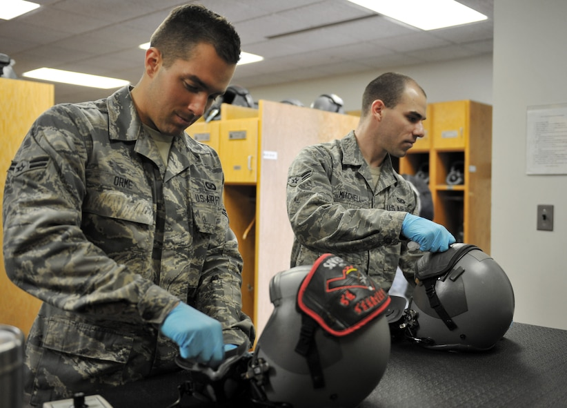 WHITEMAN AIR FORCE BASE, Mo. -- Airman 1st Class Devin Orme and Airman 1st Class Eric Mitchell, 509th Operations Support Squadron aircrew flight equipment journeymen, clean oxygen masks, Jan. 18. Aircrew flight equipment specialists inspect, maintain and adjust life support and survival gear for flight-crew members assigned to Whiteman AFB. (U.S. Air Force photo/Heidi Hunt) (Released)