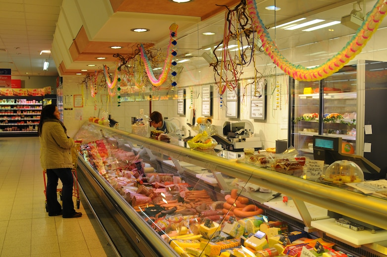 SPEICHER, Germany – A butcher helps a customer in the deli section of a supermarket Jan. 29, 2013. Most supermarkets carry at least a dozen different dairy and meat products, to include cheeses from Holland, Belgium and France; fresh meats and different sausages.  Supermarkets here carry most items U.S.  market offers, depending on the size of the market. (U.S. Air Force photo by Iris Reiff/Released)