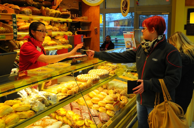 SPEICHER, Germany – A baker at a local supermarket sells baked goods to patrons Jan. 29, 2013. Most supermarkets have a bakery located inside or outside their facilities. Fresh breads are available, including whole grain products, broetchen, donuts and cake. (U.S. Air Force photo by Iris Reiff/Released)