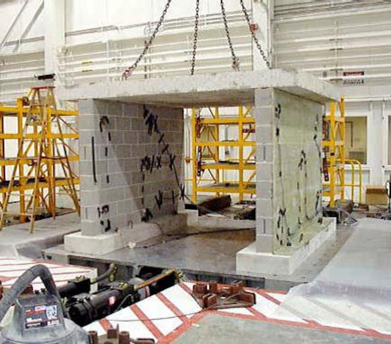 "CERL uses the Triaxial Earthquake and Shock Simulator (TESS), a three-dimensional ""shake table,"" to test the durability of ERDC systems and facilities under hazardous conditions."