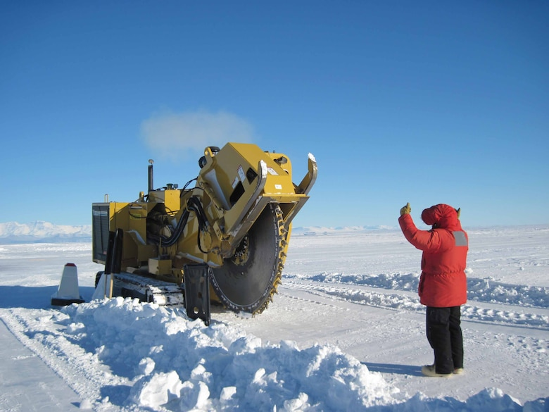 CRREL researchers prepare an area of the Pegasus White Ice Runway to install temperature probes at McMurdo Station, Antarctica.