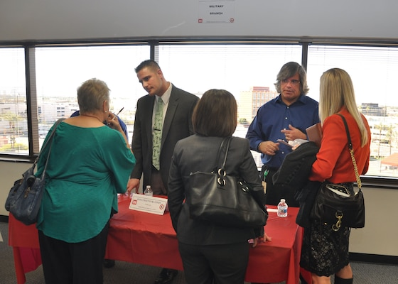PHOENIX -Jonathan Stratton (left) and Joe Derungs, both with the U.S. Army Corps of Engineers Los Angeles District's Arizona/Nevada Area Office, speak with business representatives during the first Business Opportunities Open House held Jan. 29 at the District's downtown Phoenix office. Nearly 300 business owners and operators spoke with District representatives during the event designed to let business people learn about contract opportunities and gain insight on how to do business with the Corps.