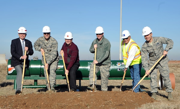 ALTUS AIR FORCE BASE, Okla. – Members of the U.S. Army Corps of Engineers, Reliable Contracting Group, and Altus AFB pose for a picture at the Jet Propellant 8 Fuel Transfer Line groundbreaking, Jan. 23. The groundbreaking was held to kick-off the reestablishment of a steel pipeline, which will connect the bulk fuel storage area to the tanker ramp providing a reliable and efficient way to refuel KC-135 Stratotankers. The fuel line is projected to cost more than $9 million and will save the base money over time through saved man hours and truck deliveries