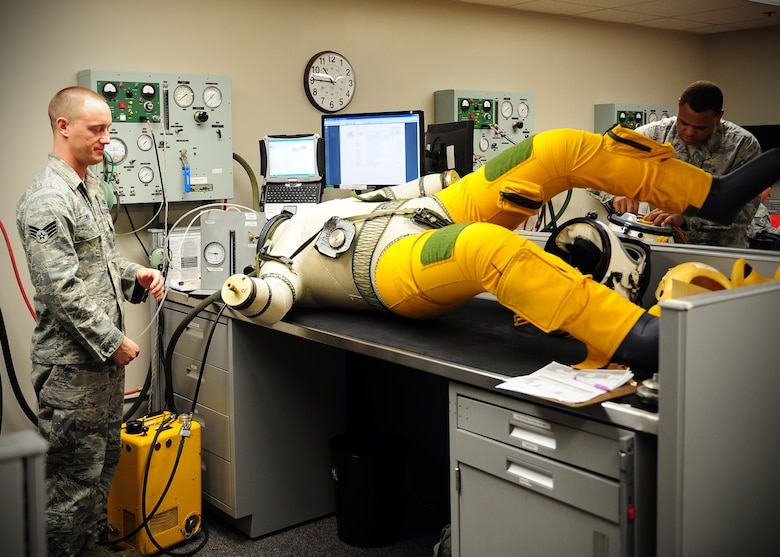 Senior Airman Joshua Fike (left) and Louis Iverson, 9th Physiological Support Squadron suit maintenance technicians, run a pressure sensor test on a full pressure suit at Beale Air Force, Calif., Jan. 24, 2013. The suits, which are used by U-2 Dragon Lady pilots, receive a full maintenance inspection every 90 to 120 days or as needed. Each test takes up to three hours to ensure pilot safety in case of depressurization at high altitude. (U.S. Air Force photo by Senior Airman Shawn Nickel/Released)