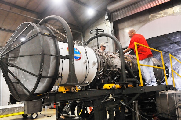 Hugh Rooks and Brian Greenwood, jet engine mechanics, prepare an F-15 engine for a  run test. The F-15 Engine Shop received its VPP Gold Banner in January.(U. S. Air Force photo/Sue Sapp)