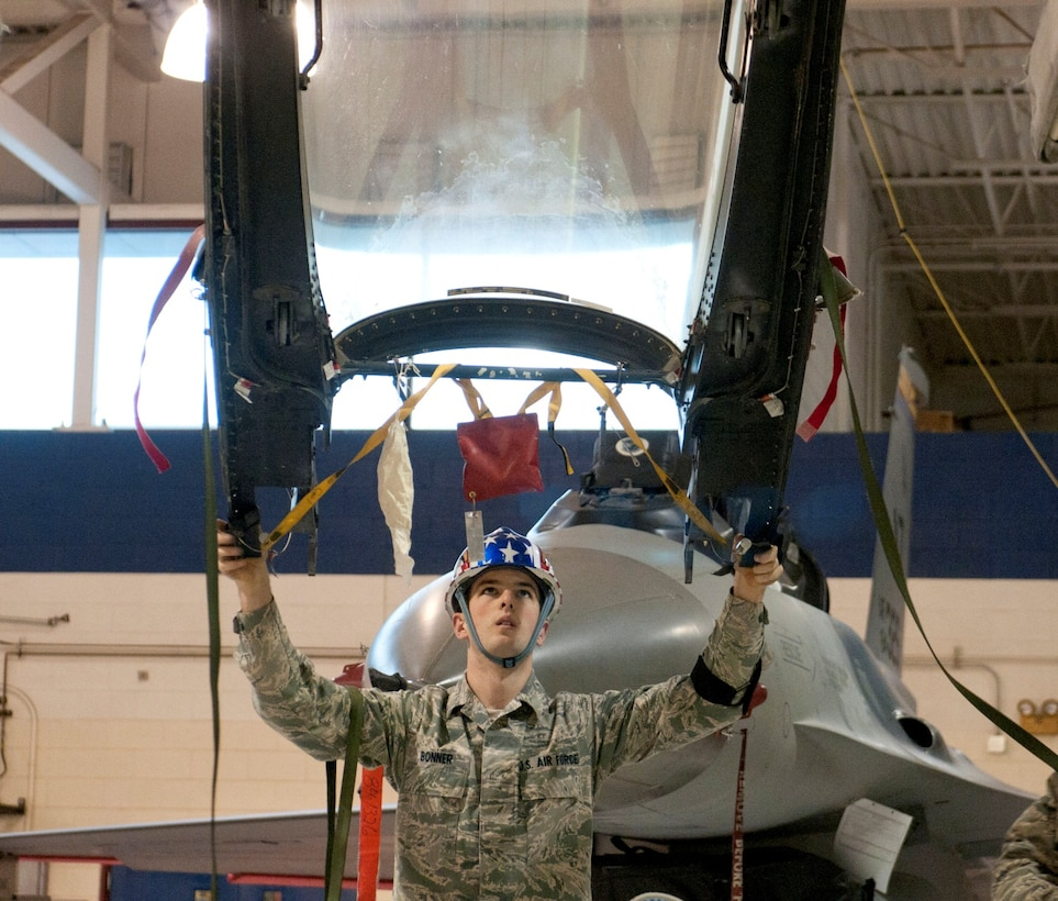 U. S. Air Force Airman 1st Class Jacob Bonner, an Aircrew Egress Systems Specialist, guides an F-16 canopy to a canopy dolly for scheduled egress time change maintenance in Hangar 12 at the 162nd Fighter Wing, January 13, 2013. Bonner is one of many specialists working to ensure the life support systems for the F-16 Fighting Falcon remain serviceable. (U.S. Air Force photo by Tech. Sgt. Hollie A. Hansen/Released)