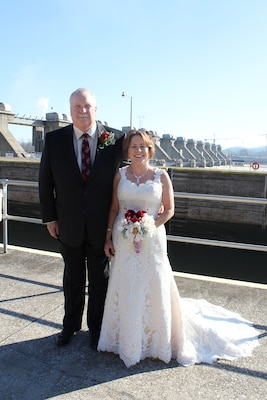 Lock Operator Janet Merritt weds Elvin Barks in a first-of-its-kind ceremony at Cannelton Locks and Dam, Cannelton, Ind., Dec. 12, 2012.