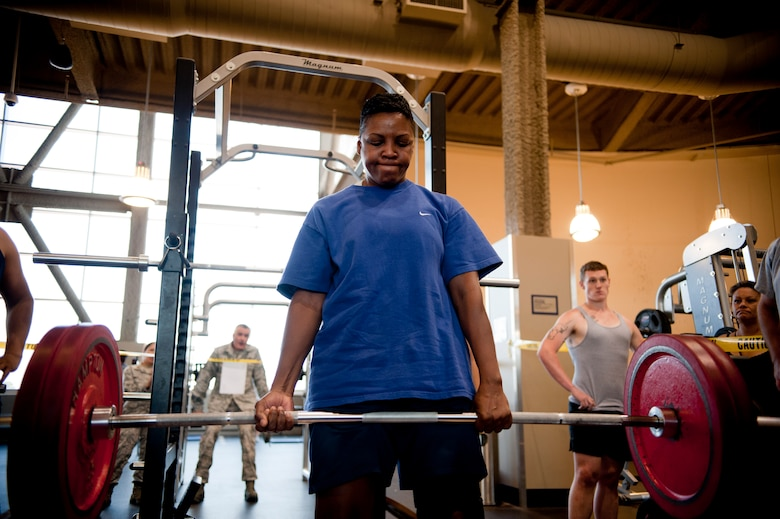 Tech Sgt. Denise Patterson, 57th Aircraft Maintenance Squadron crew chief, dead lifts during the third phase of the weight lifting competition at Nellis Warrior Fitness Center June 28, 2013. She won third place and a $10 gift card. (U.S. Air Force photo by Caitlin Kenney)
