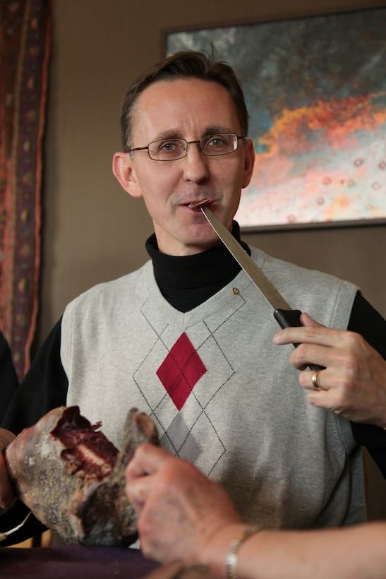 Greg Sandlin, an ATA senior engineer, partakes in a traditional 12th century Viking meal of salt-cured lamb, no fork, while visiting Norway as a Rotary Group Study Exchange team leader. (Photo Provided)
