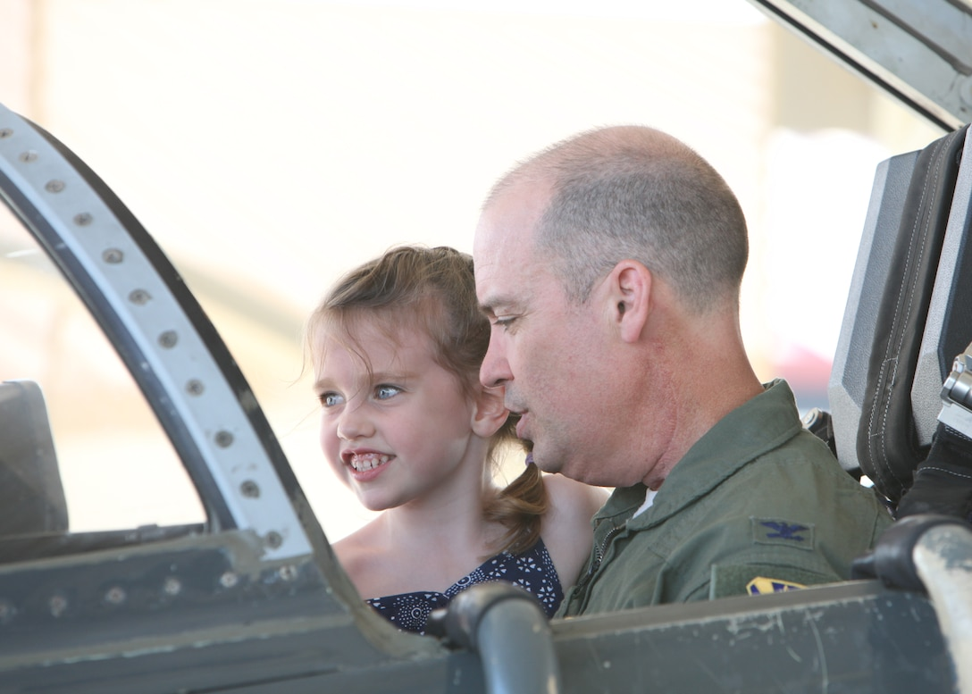 Col. David Drichta, 12th Operations Group deputy commander, shows his daughter, Natalie, the cockpit of the T-38C Talon, following his first flight back after his battle with cancer at Joint Base San Antonio-Randolph, Texas June 19, 2013.  Drichta was diagnosed with Stage IV cancer in February 2012 and, after more than a year in recovery, was medically cleared to return to flight status.  The flight marked his return to flight status as well as his 3,000th flight hour in Air Force aircraft. (Courtesy photo by Stacy Nyikos)