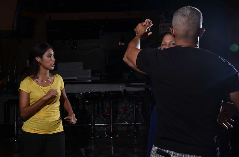 Adriana Bruton, a dance instructor on base, teaches members of Team Andersen to dance the salsa during an adult ballroom dance class on Andersen Air Force Base, Guam, June 27, 2013. Adult classes are held Tuesday and Thursday nights at the Top of the Rock on base at 7 p.m. Each month she instructs different ballroom dances, including the fox-trot, waltz, tango, salsa, rumba, swing and merengue. (U.S. Air Force photo by Staff Sgt. Veronica Montes/Released)