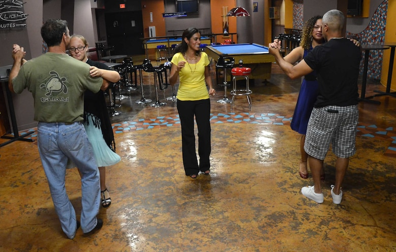 Adriana Bruton, a dance instructor on base, teaches members of Team Andersen to dance the salsa during an adult ballroom dance class on Andersen Air Force Base, Guam, June 27, 2013. Bruton arrived on Guam two years ago and since then, she's been various dances to children and adults of the Andersen community. (U.S. Air Force photo by Staff Sgt. Veronica Montes/Released)