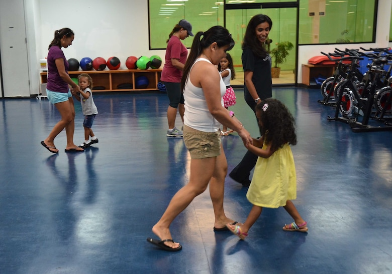Adriana Bruton, a dance instructor on base, teaches students and their parents fox-trot during a youth ballroom dance class on Andersen Air Force Base, Guam, June 26, 2013. Bruton instructs ages 3 and older and allows parents to join in once a month to learn the steps with their children. (U.S. Air Force photo by Staff Sgt. Veronica Montes/Released)
