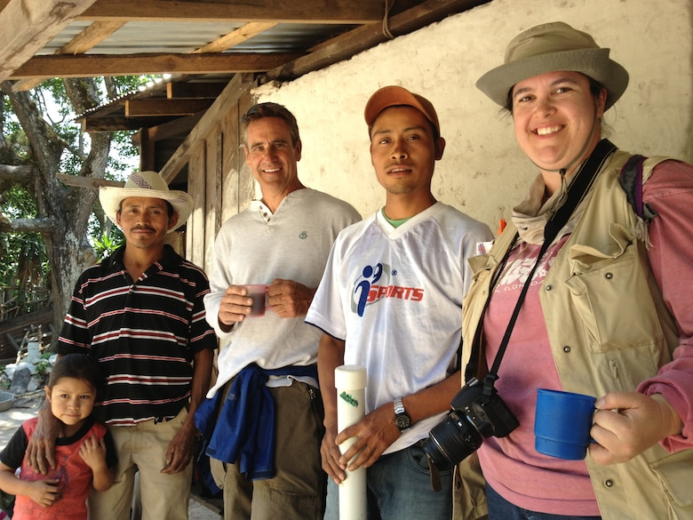 Engineers Without Borders traveled to the community of Las Vegas in the Nahuaterique region of Honduras in May 2013, to gain water rights from landowners and establish community relations.  Crystal Markley (right) is pictured with (l to r) Santos Cristobal (Treasurer of the Las Vegas Water Board) and his daughter , EWB-USA team member Rich Roberts and an unknown community team member.