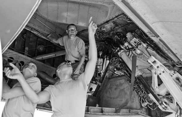 Crew chiefs from the 36th Expeditionary Aircraft Maintenance Squadron perform preflight checks on a B-52 Stratofortress July 2, 2013, on the Andersen Air Force Base, Guam, flightline. Members of the 36th EAMXS are deployed here from Minot Air Force Base, N.D., to provide maintenance support to the 23rd Expeditionary Bomb Squadron. (U.S. Air Force photo by Airman 1st Class Marianique Santos/Released)