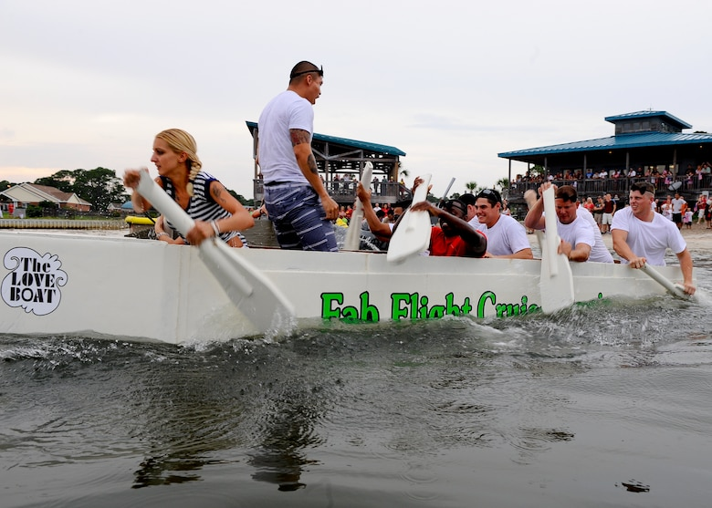 Members of the 1st Special Operation Equipment Maintenance Squadron, defending champions row their boat The Fab Love Boat to a second place finish during the 25th annual cardboard boat regatta at the Soundside Marina on Hurlburt Field Fla., June 28, 2013. The 1st SOEMS valiantly defended their title but came short and accepted defeat to the 823rd RED HORSE. (U.S. Air Force photo by Airman 1st Class Jeffrey Parkinson)