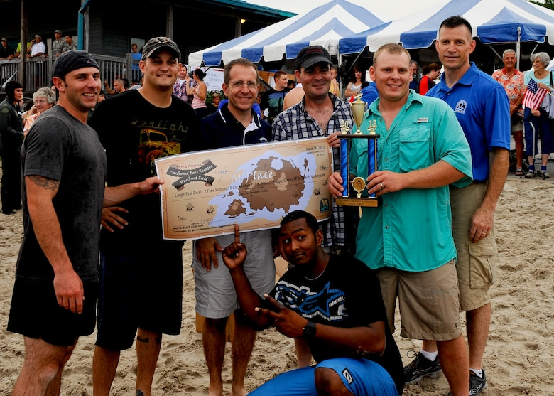 The 823rd RED HORSE is awarded the first place prize by Col. Jim Slife, commander of the 1st Special Operations Wing, at the 25th Annual cardboard boat regatta at the Soundside Marina on Hurlburt Field, Fla., June 28, 2013.  (U.S. Air Force photo by Airman 1st Class Jeffrey Parkinson)