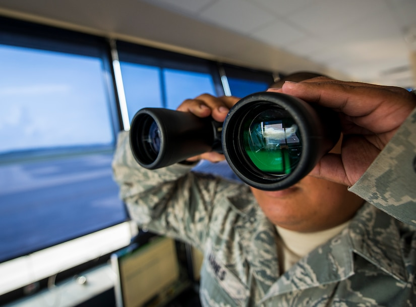 Staff Sgt. Vincent Barnes, 437th Maintenance Group Air Terminal Operation Center controller, scans the Joint Base Charleston – Air Base flight line while in the ATOC, June 25, 2013, at JB Charleston – Air Base, S.C. ATOC controllers are the eyes and ears of the flight line, checking tail numbers and making sure all aircraft are in the correct place. (U.S. Air Force photo/ Senior Airman Dennis Sloan)