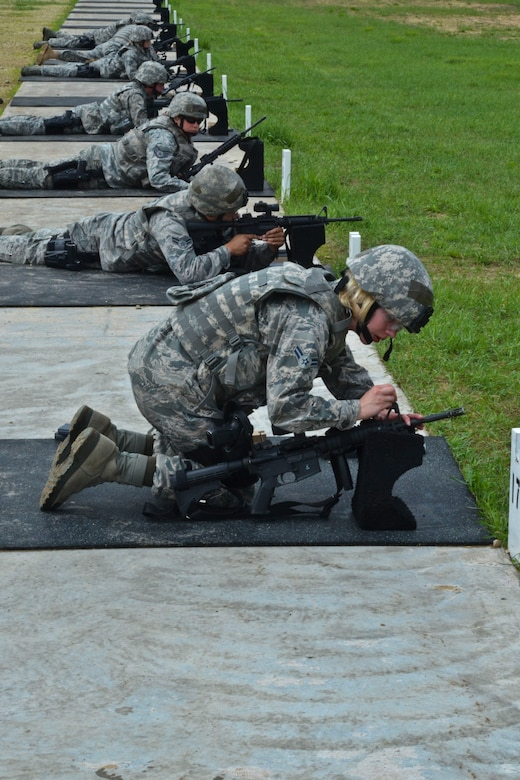 U.S. Air Force Airman 1st Class Courtney Metzger, a security forces member with the 128th Air Refueling Wing, Wisconsin Air National Guard, adjusts the sights on her M4 rifle while participating in weapons qualification at Fort McCoy, Wis., June 10, 2013.  Members of the 128th Security Forces Squadron conducted annual training at Total Force Training Center Fort McCoy.  (U.S. Air National Guard photo by Staff Sgt. Jenna Hildebrand/Released)