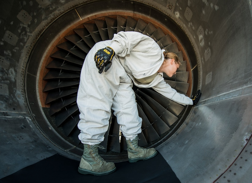 Staff Sgt. Jennifer Smith, 437th Maintenance Group jet-propulsion specialist, runs her hand along the inside of a C-17 Globemaster III engine inspecting for cracks, bumps or other flaws during a routine maintenance check June 26, 2013, at Joint Base Charleston – Air Base, S.C. Airmen from the 437th MXG perform routine maintenance to  C-17s daily. (U.S. Air Force photo/ Senior Airman Dennis Sloan)
