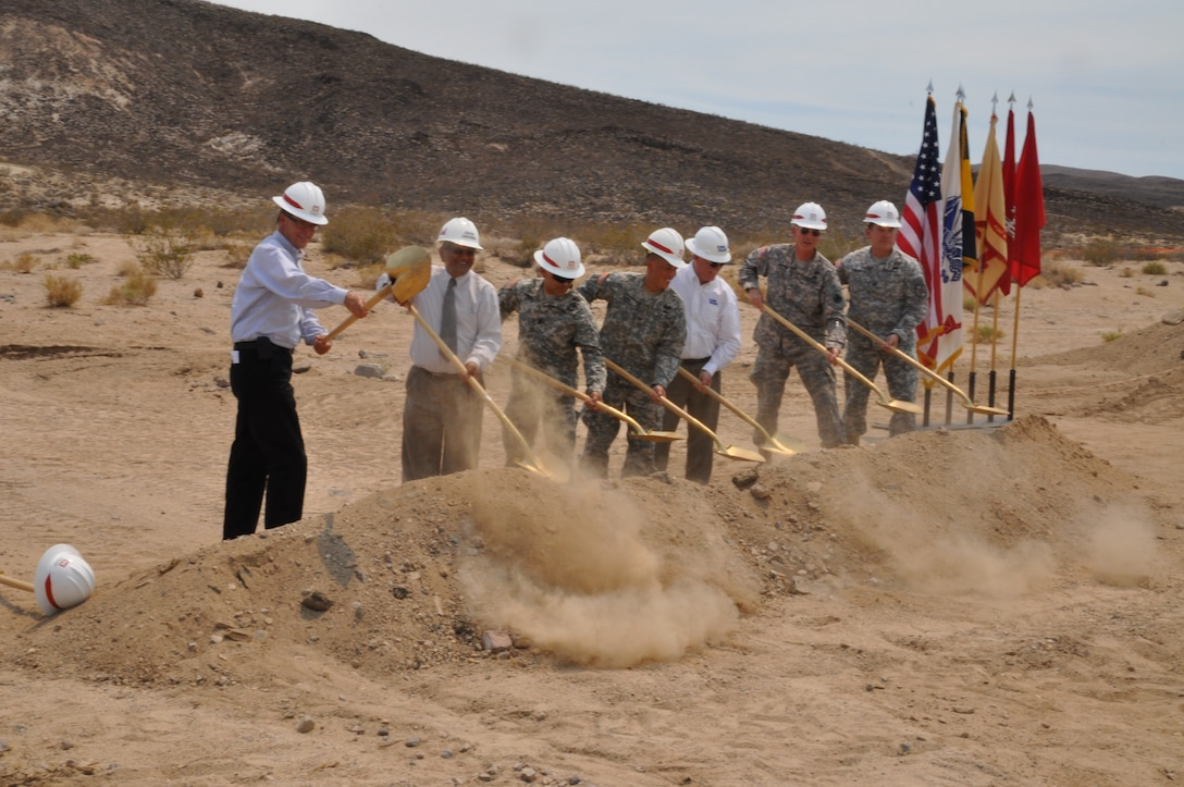 (From left) John Keever, Muhammad Bari, Command Sgt. Maj. Dale Perez, Col. Mark Toy, Peter Tunnicliffe, Brig. Gen. Ted Martin and Col. Kurt Pinkerton break ground during a ceremony June 28 commemorating the start of construction of the new water treatment plant at the National Training Center at Fort Irwin, Calif. The U.S. Army Corps of Engineers Los Angeles District is overseeing the construction of the design-build effort by CDM