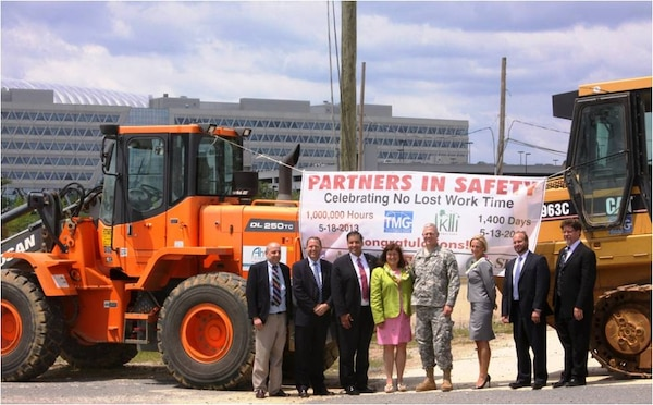 Representatives of USACE Headquarters, USACE Baltimore District, AKHI Construction, TMG Construction and Ahtna Engineering celebrate important safety milestone during construction at the Fort Belvoir New Campus East.