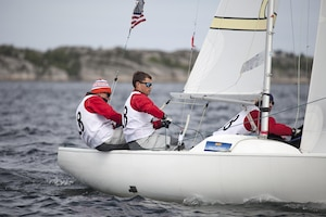 US Men take sail during the 2013 CISM World Military Sailing Championship 27 June to 4 July at the Askoy Yacht Club in Bergen, Norway.  (Left to right) Skipper ENS Taylor Vann, LTJG Jonathan Duffet, and LCDR Luke Suber.