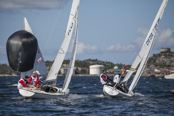 Team USA Men led by skipper ENS Taylor Vann are make their move in an attempt to pass Team Spain during the 2013 CISM World Military Sailing Championship at the Askoy Yacht Club in Bergen, Norway 27 June to 4 July.