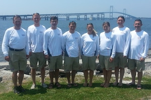 The 2013 US Armed Forces Men and Women Sailing Teams prepare for the 2013 CISM World Military Sailing Championship held in Bergen, Norway 27 June to 4 July.  Team USA prepared in Newport, RI under the leadership of Navy Captain Eric Irwin (Chief of Mission) and Navy Commander Dexter Hoag (Coach).  From left to right:  CAPT Eric Irwin, Navy; ENS Taylor Vann, Navy (Mens Skipper); LCDR Luke Suber, Navy (Mens Crew); LTJG Jonathan Duffet, Coast Guard (Mens Crew); LT Trisha Kutkiewicz, Navy (Womens Skipper); LTJG Krysta Tufts, Coast Guard (Womens Crew); LT Elizabeth Tufts, Coast Guard (Womens Crew); CDR Dexter Hoag, Navy.