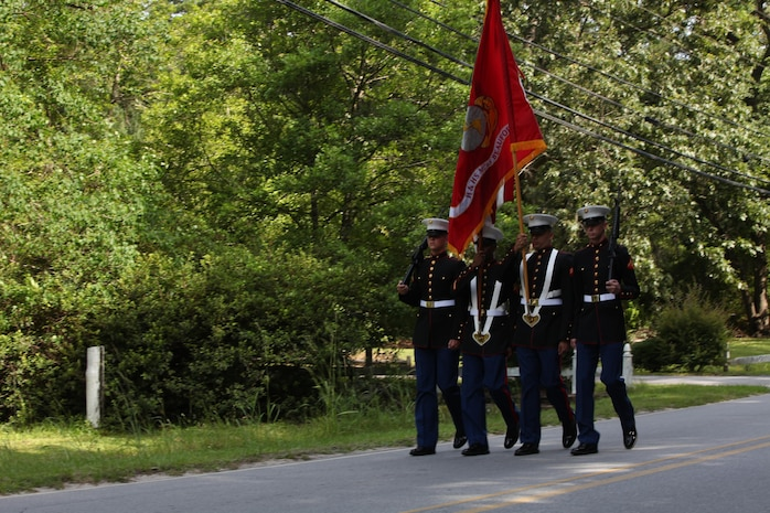 Marines with the Marine Corps Air Station Beaufort Color Guard lead the way during the City of Rincon's 4th of July Parade in Rincon, Ga., June 29. The Marines marched to represent the Corps for the annual event.