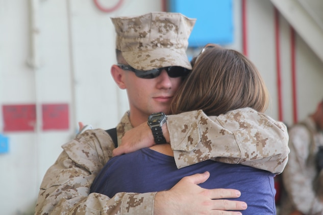 Cpl. Carl Young, a consolidated automatic support system Marine for Marine Aviation Logisitcs Squadron 31, says goodbye to his wife before board a plane to go on a six-month deployment, June 28. The Stingers will be supporting MALS-40 and Operation Enduring Freedom by offering aircraft, ordnance and maintenance support.